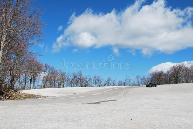 Blue skies, snow on the ground, top of a hill stock image
