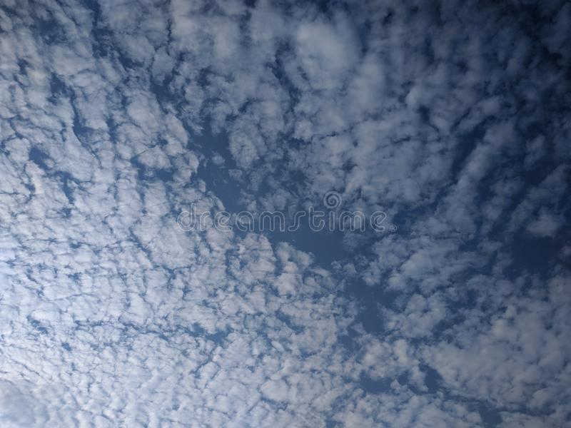 Blue sky with abstract white clouds royalty free stock photo