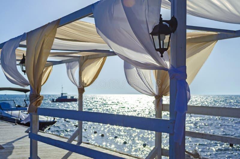Blue sky and aquamarine seas at Black Sea. Anchored are fishing boats and sailboats stock photography