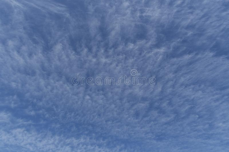 Blue sky backdrop or overlay displaying cloud movement. stock photography