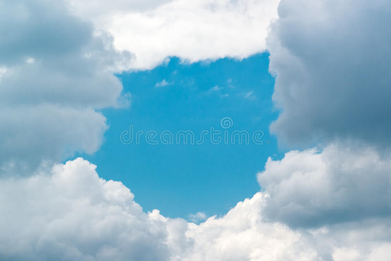 Blue Sky Background as Hole in White Clouds royalty free stock images