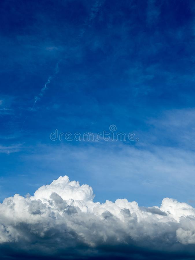 Blue sky background with clouds. Fuffy clouds on bright blue sky background,air royalty free stock photos