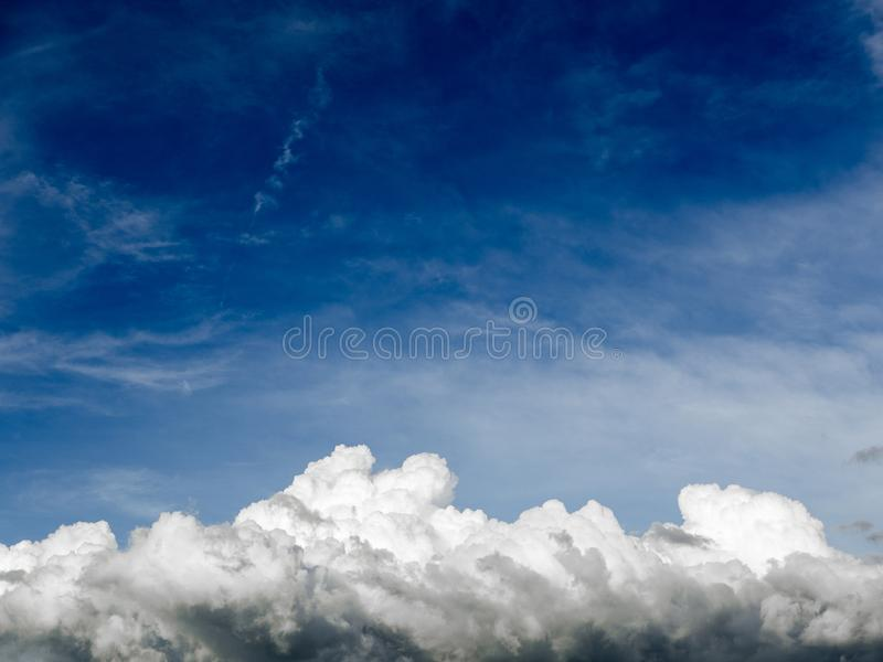 Blue sky background with clouds. Fuffy clouds on bright blue sky background,air royalty free stock image