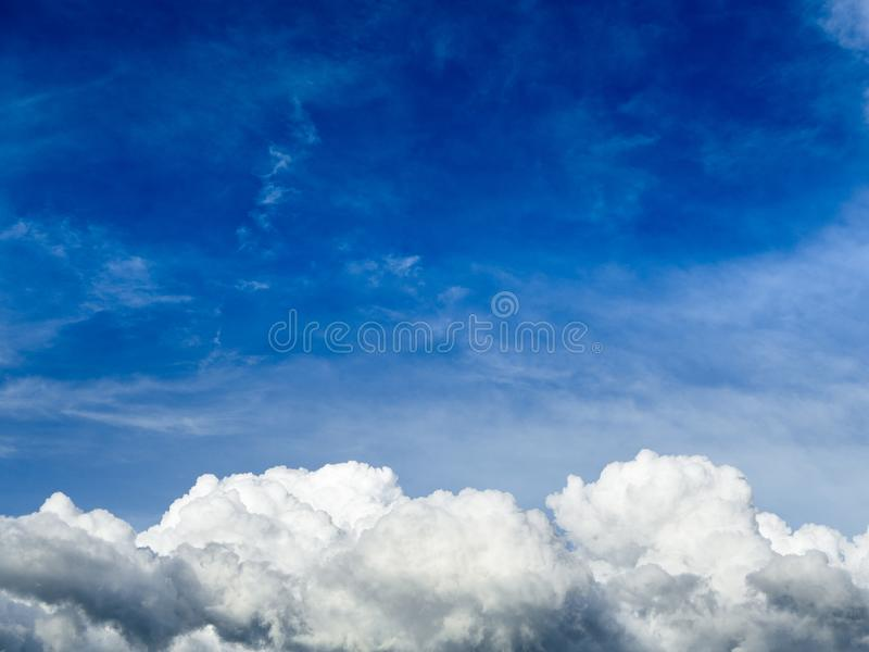 Blue sky background with clouds. Fuffy clouds on bright blue sky background,air stock photography
