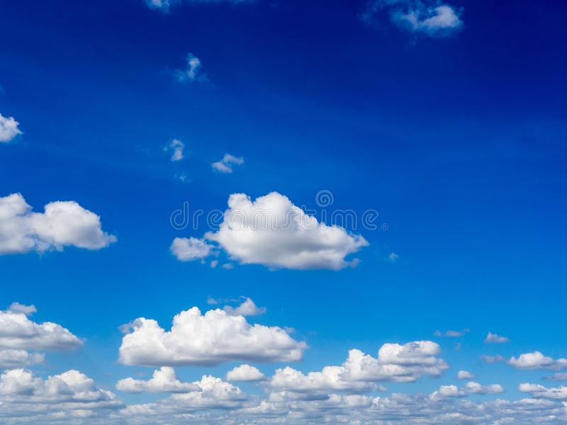 Blue sky background with clouds. Fuffy clouds on bright blue sky background,air stock photo