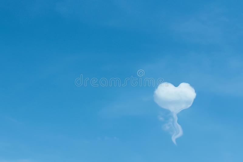 Blue sky background and single white clouds in heart shaped balloon patterns concept floating , copy space. Close up Blue sky background and single white clouds royalty free stock photography