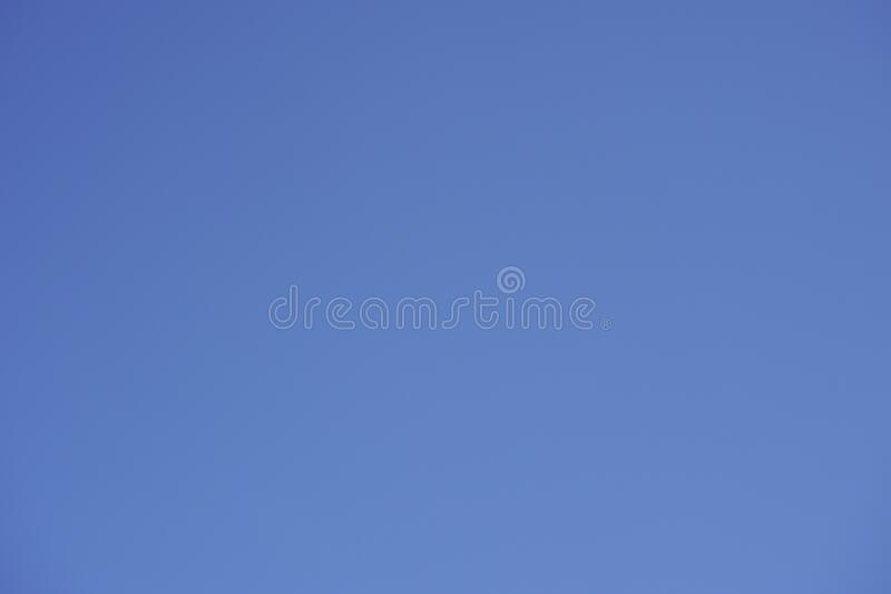 Blue sky Background on a very sunny day royalty free stock image
