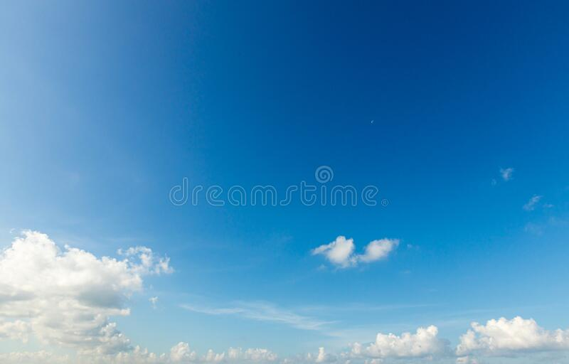 Blue sky background with tiny clouds. Sky is a beautiful patterned cloud in the daytime during the summer is a panoramic image.  stock photography