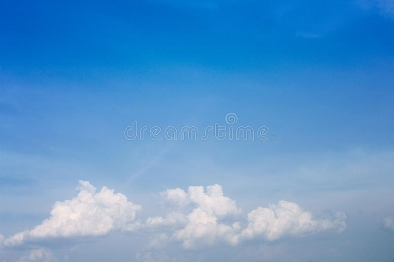 Blue sky background with white clouds group patterns and copy space. Close up Blue sky background with white clouds group patterns and copy space royalty free stock images