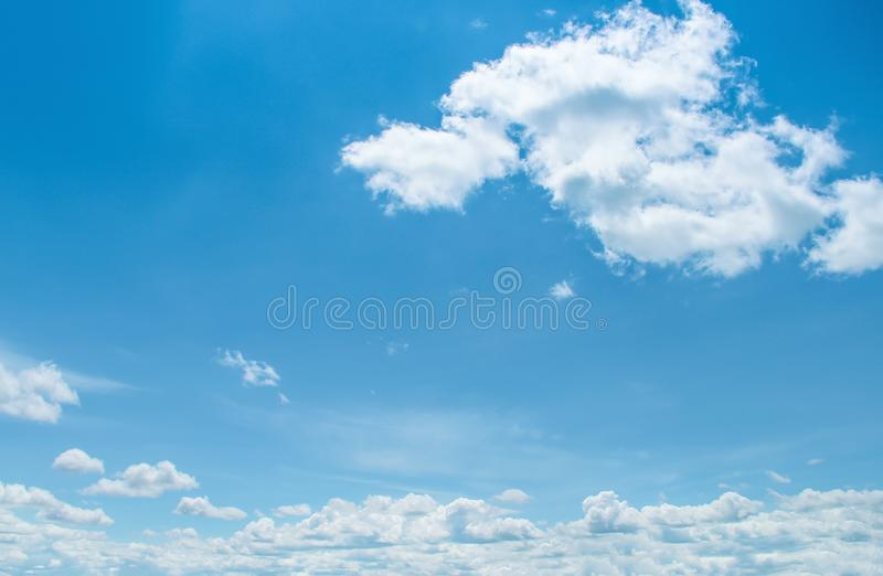 Blue sky background with white clouds group shaped patterns floating in summer day , copy space. Close up Blue sky background with white clouds group shaped stock photography