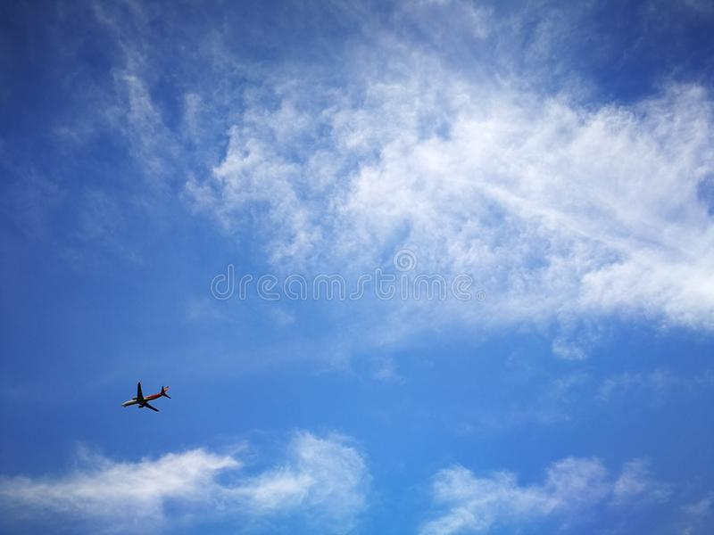 Blue sky background and white clouds soft focus. And copy space stock photo
