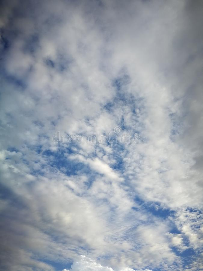 Blue sky background and white clouds soft focus. And copy space royalty free stock photo