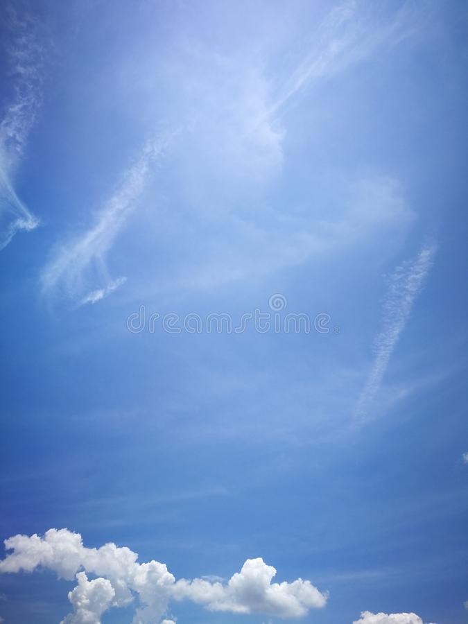 Blue sky background and white clouds soft focus. And copy space stock images