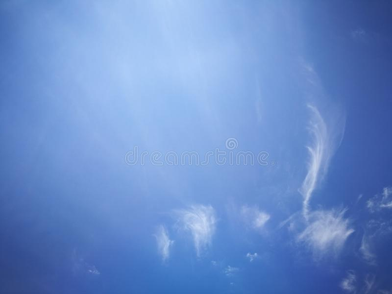 Blue sky background and white clouds soft focus. And copy space royalty free stock photos