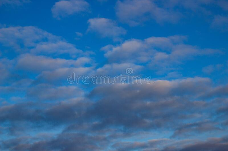 Blue sky background with white and gray clouds. Beautiful image of a huge sky and clouds.  stock image