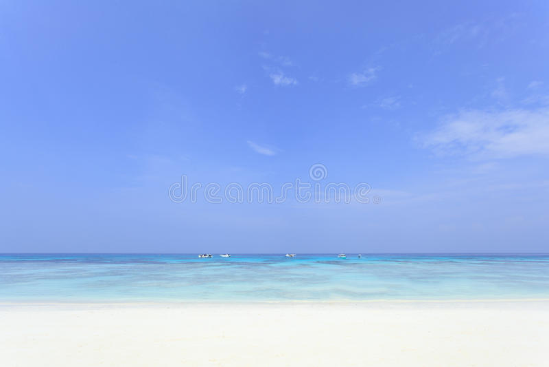 Blue sky and white sand beach stock photo