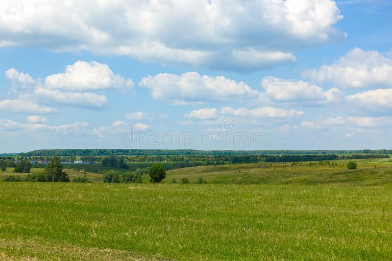 Blue sky and beautiful cloud with meadow tree. Plain landscape background for summer poster. The best view for holiday.  royalty free stock images