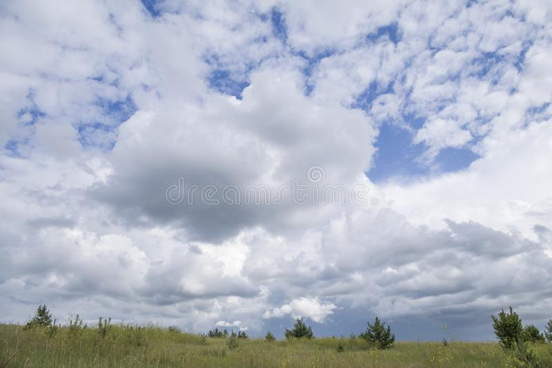 Blue sky and beautiful cloud with meadow tree. Plain landscape background for summer poster.  royalty free stock photos