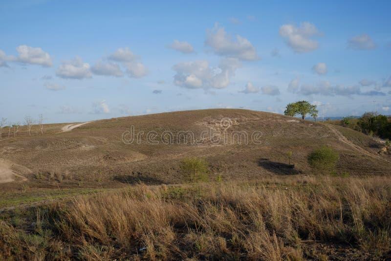 Blue sky, beautiful clouds, Savanna Sumba Island. Blue sky, beautiful clouds, above the savanna of Lolomogho hill, Southwest Sumba border with West Sumba NTT stock photos