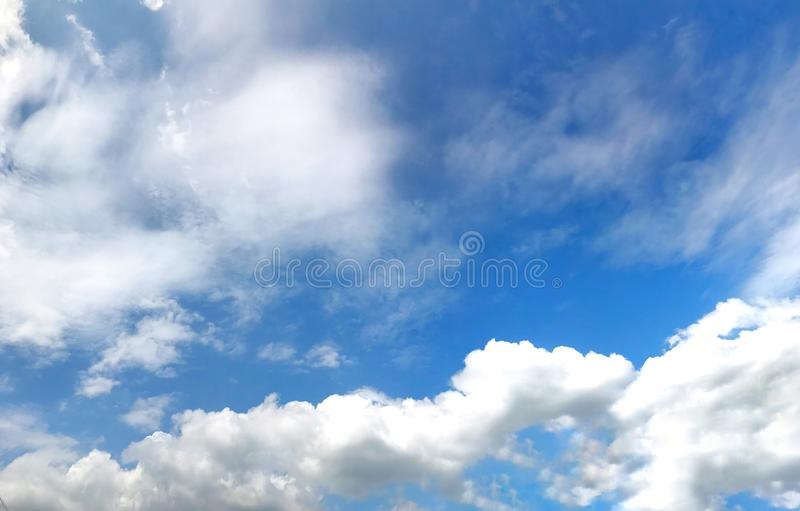 Beautiful blue sky with clouds for background and bright lighting clear on Summer royalty free stock photo