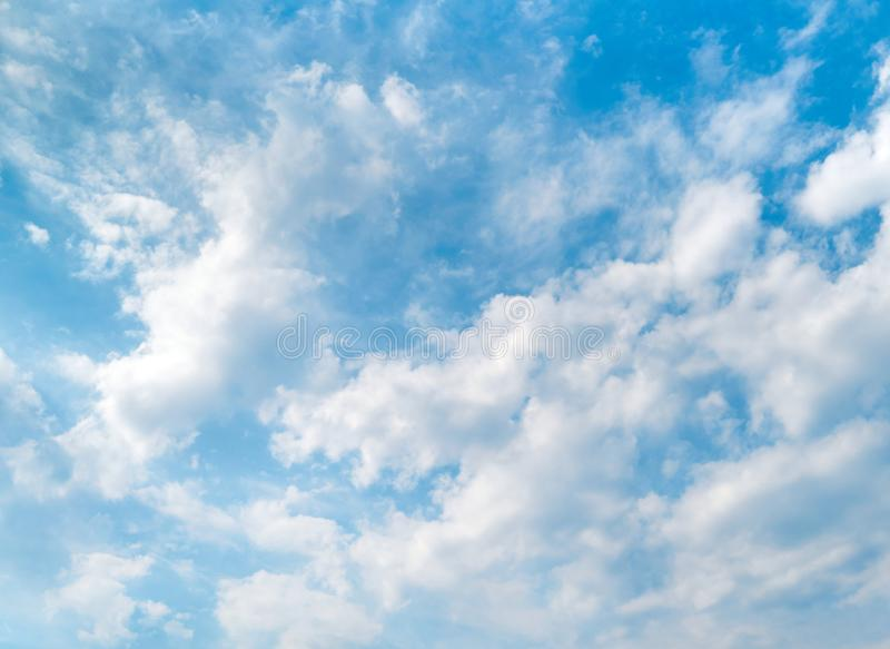 Blue sky and beautiful white clouds. Bright sunny day. Background with copy space stock image