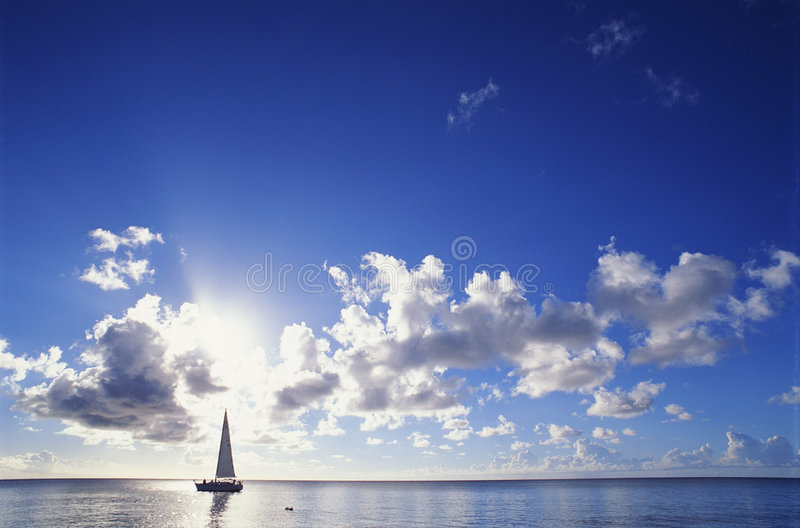 Blue Sky and boat. Blue sky with clouds with sun, calm sea and boat royalty free stock photography