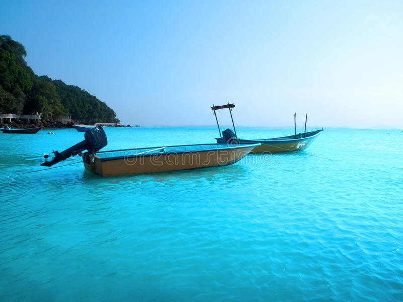 Blue sky with boats. 2 boats at the calm sea in early morning stock photos