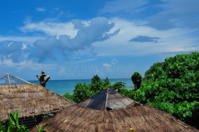 Blue sky with bungalows royalty free stock photography