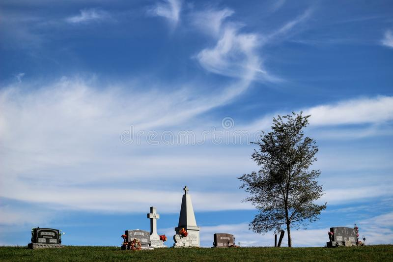 Blue sky cemetery stock images