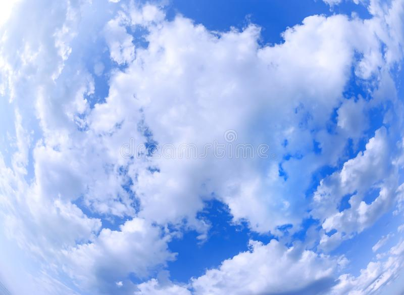 Blue sky and cirrus clouds all over the frame. Bright saturated colors. Wide angle fisheye royalty free stock image