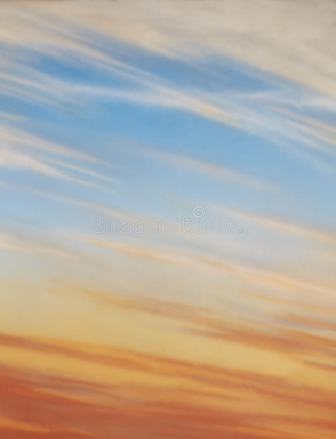 Blue sky with cirrus clouds and sunset. Sunset, blue sky and wispy clouds stock image