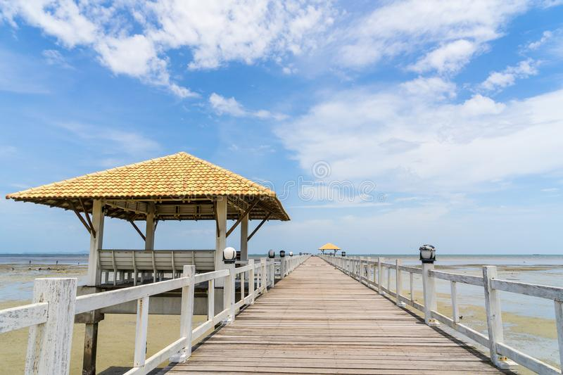 Blue sky clear with perspective wooden bridge extending into the royalty free stock image