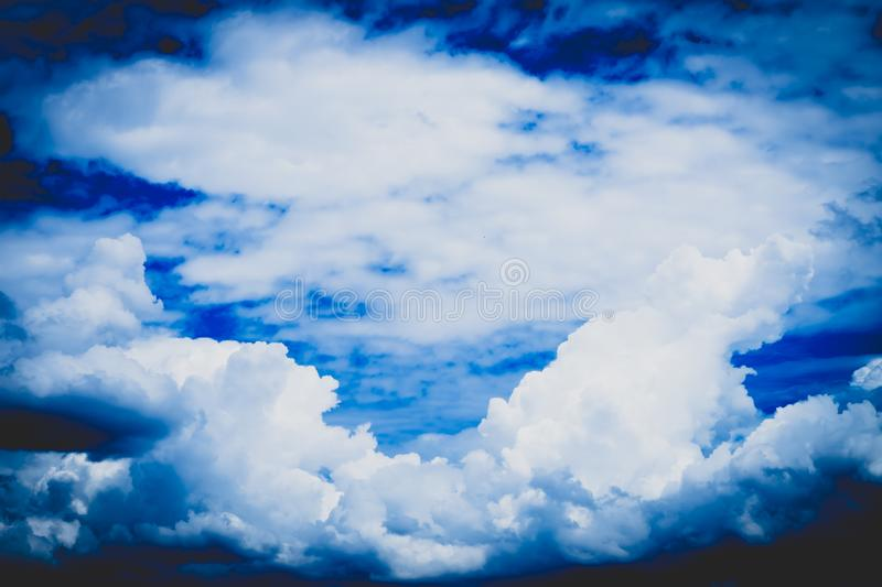 Blue sky with cloud closeup . Sunlight with blue sky on dark background.Vivid sky on white cloud. nature clouds-cape background royalty free stock photography