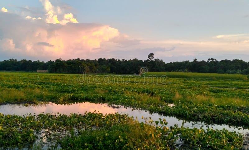 Dark cloudy sky at sunset royalty free stock photo