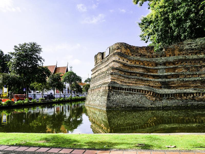 Morning in Chiang Mai, Old city wall in Thailand. Blue sky and cloud, Water, slow life in Chaing Mai, Northern Thailand. Beatiful landscape. Old brow bricks royalty free stock images