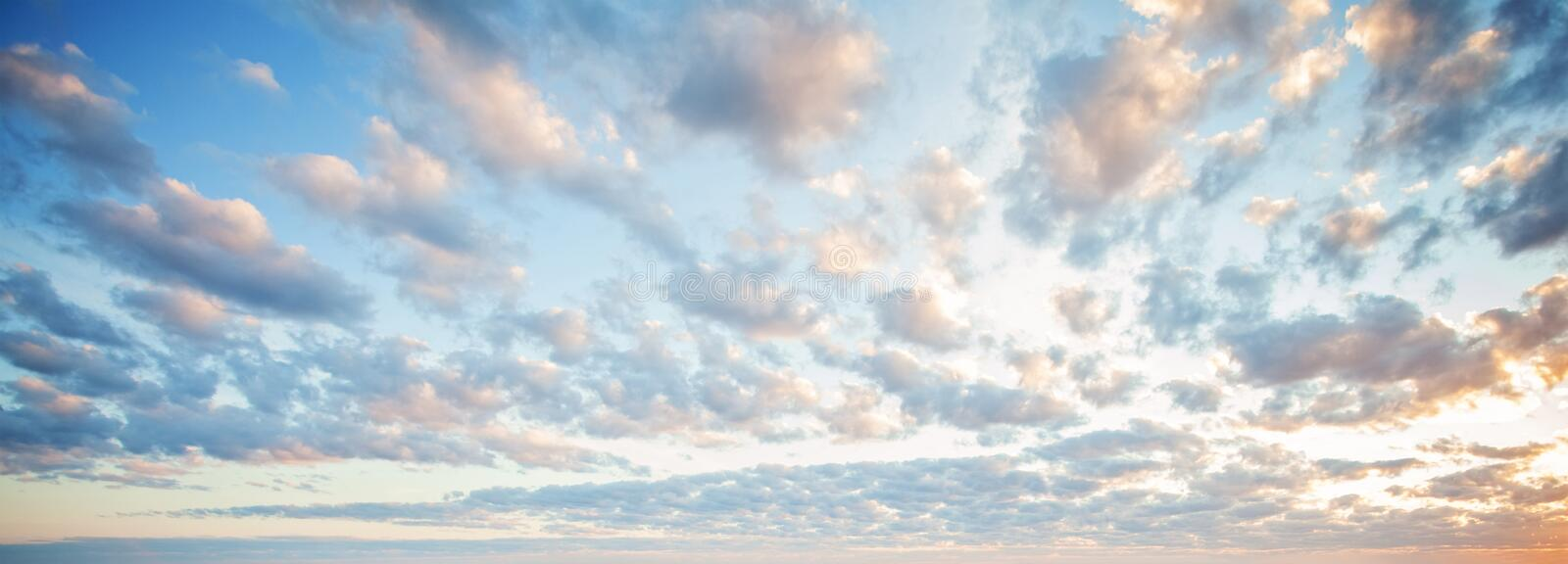Blue sky clouds background. Beautiful landscape with clouds and orange sun on sky.  stock photos