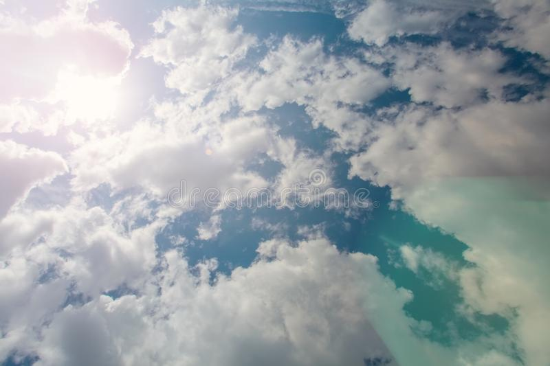 Blue sky clouds background. Beautiful landscape with clouds and sun.  stock photography