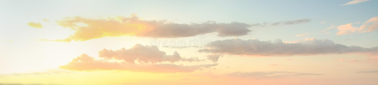 Blue sky clouds background. Beautiful landscape with clouds and sunset.  stock photos