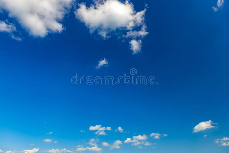 Blue sky with clouds background. High resolution royalty free stock photo