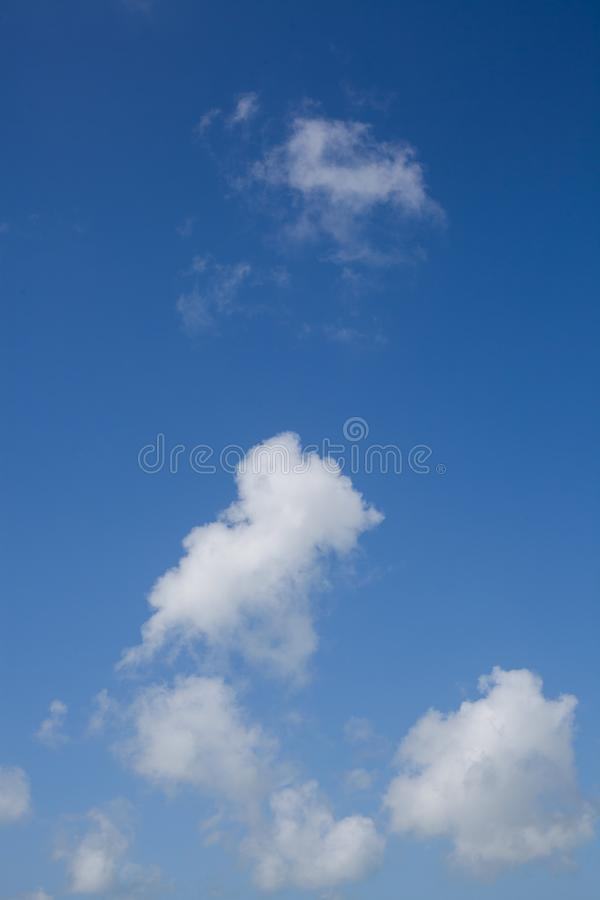 Blue sky with clouds background. Cloudscape. Beautiful soft clouds on blue sky background. Abstract cloud background. stock photography