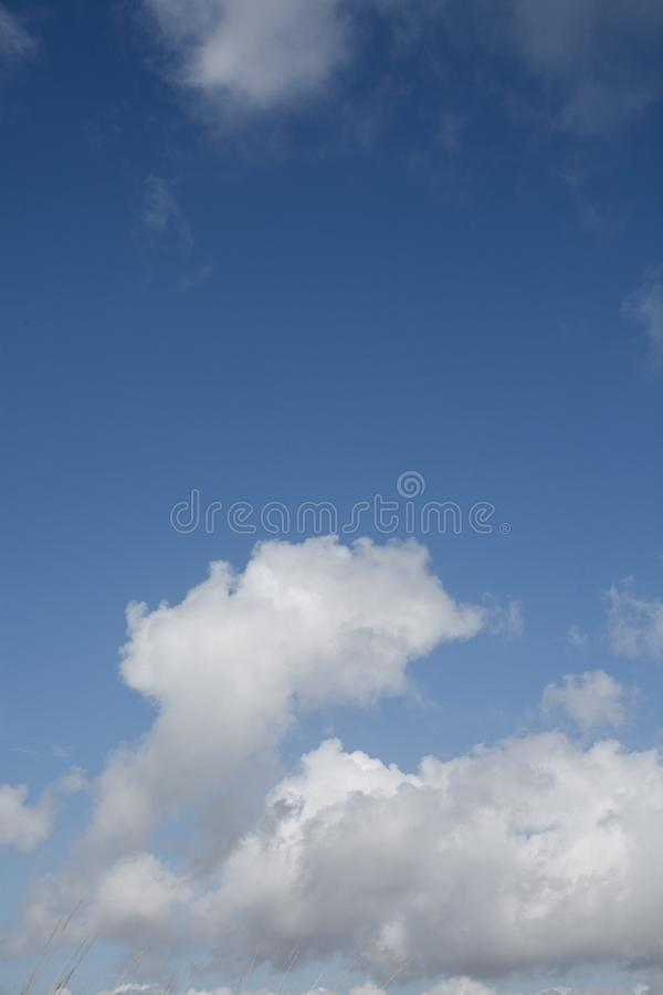 Blue sky with clouds background. Cloudscape. Beautiful soft clouds on blue sky background. Abstract cloud background. stock images