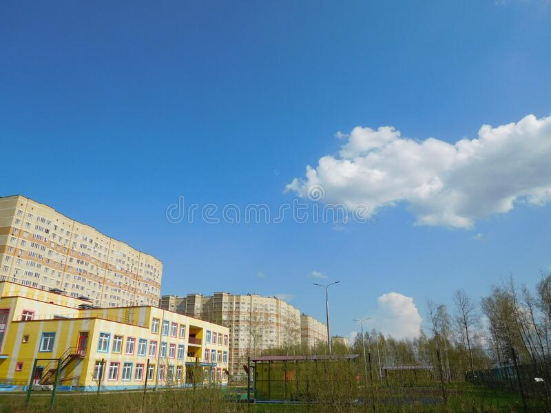 Blue sky and clouds background image and high-rise apartment buildings royalty free stock image
