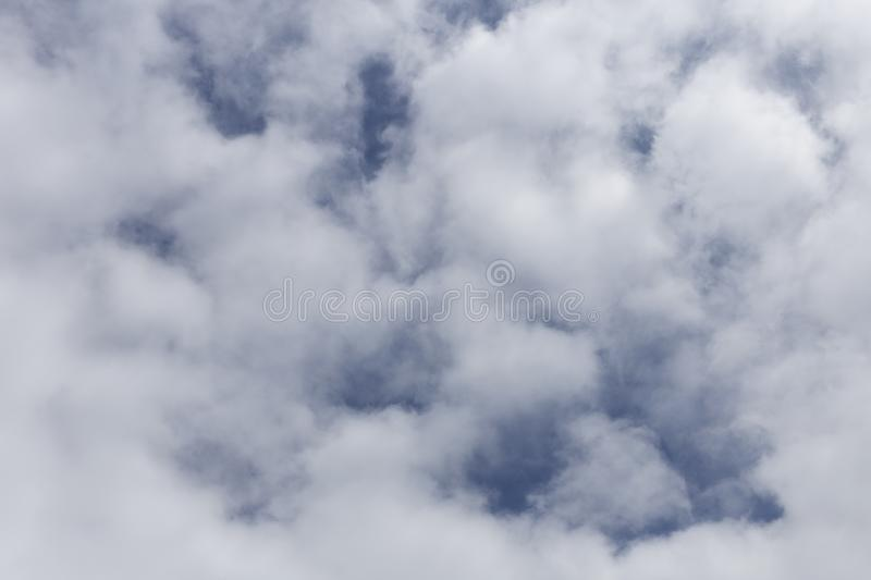 Blue sky with clouds. Background of white and gray clouds royalty free stock photo