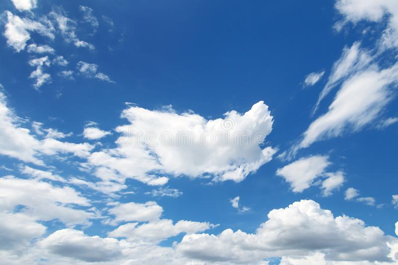 Blue sky and clouds. On background royalty free stock images