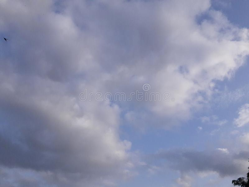 This is the blue sky and clouds. Beautiful, beauty, nature, natural, atmisphere, heaven, abstract, asia, air, maharashtra, indian, rural, village royalty free stock photo