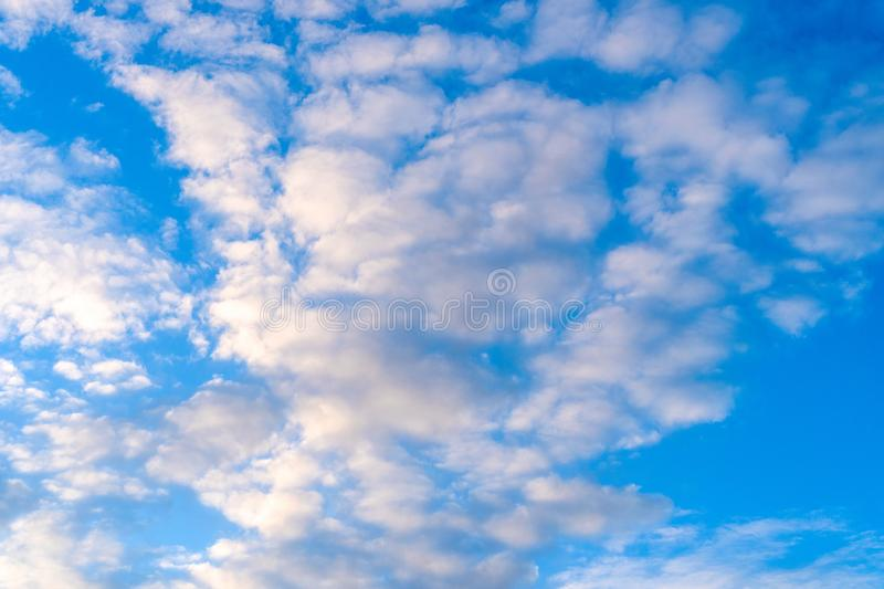 Blue sky with clouds on a bright sunny day.  royalty free stock images
