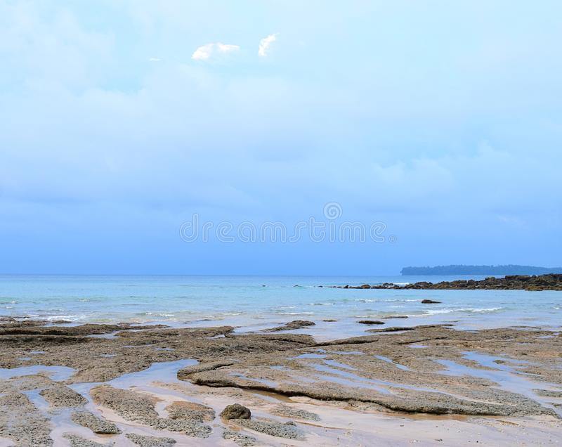 Blue Sky with Clouds and Calm Sea Water at Rocky and Sandy Beach - Natural Background Seascape - Sitapur, Neil Island, Andaman stock photo
