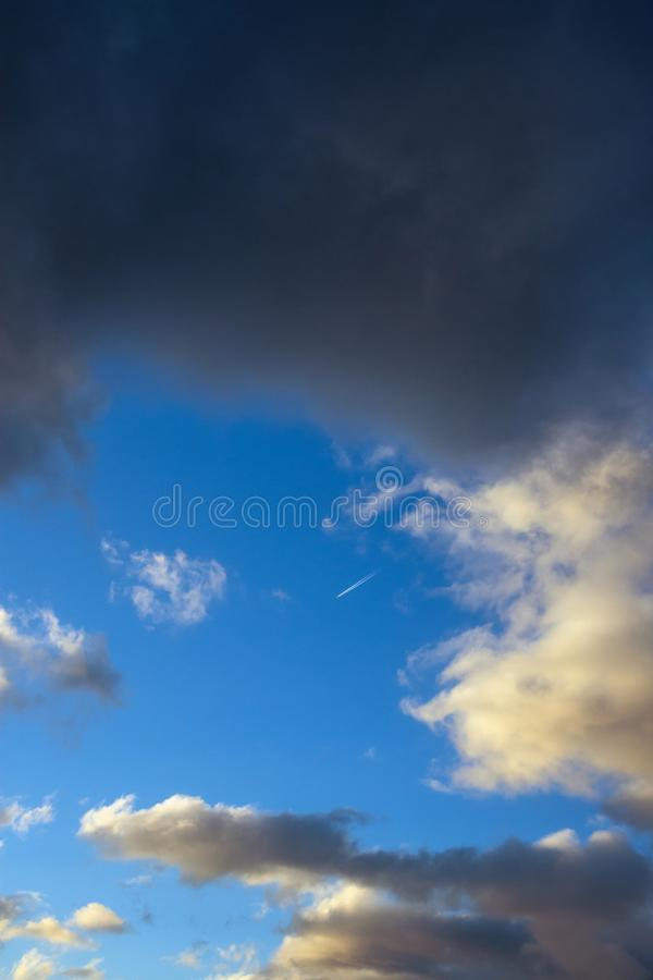 Sky and clouds colored by evening light. Blue sky and clouds colored by evening light stock images