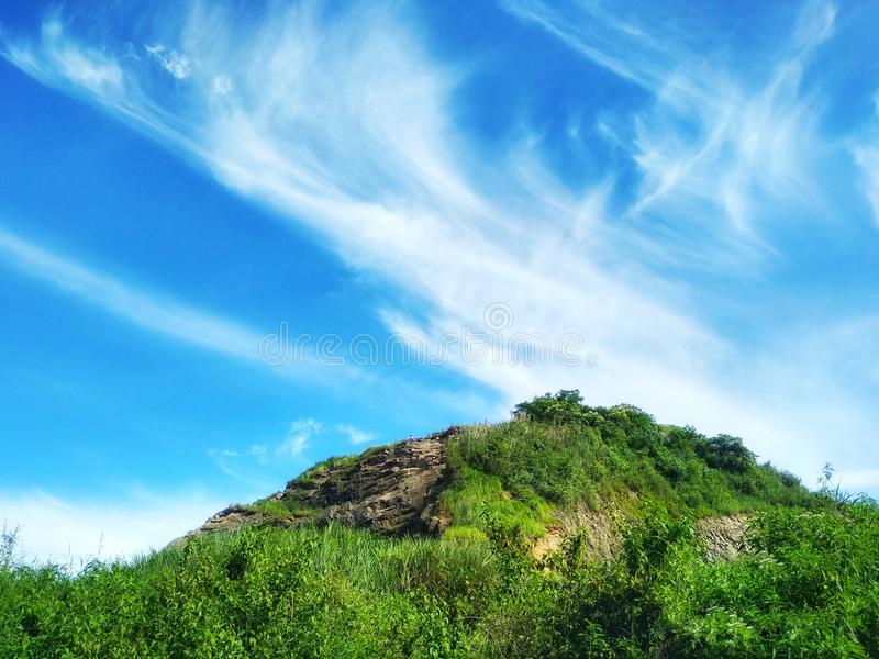 Blue sky and clouds on the mountain image. Blue sky clouds mountain image stock photos