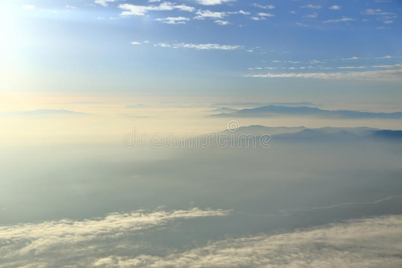 Blue sky with clouds and mountains royalty free stock photography